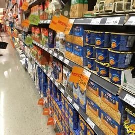 A sale on Kraft Dinner products at Massine's Your Independent Grocer on Somerset and Bank Streets. Healthy options are often more expensive than processed products. [Photo © Nadiah Sakurai]