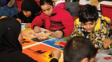 Syrian children painting for charity