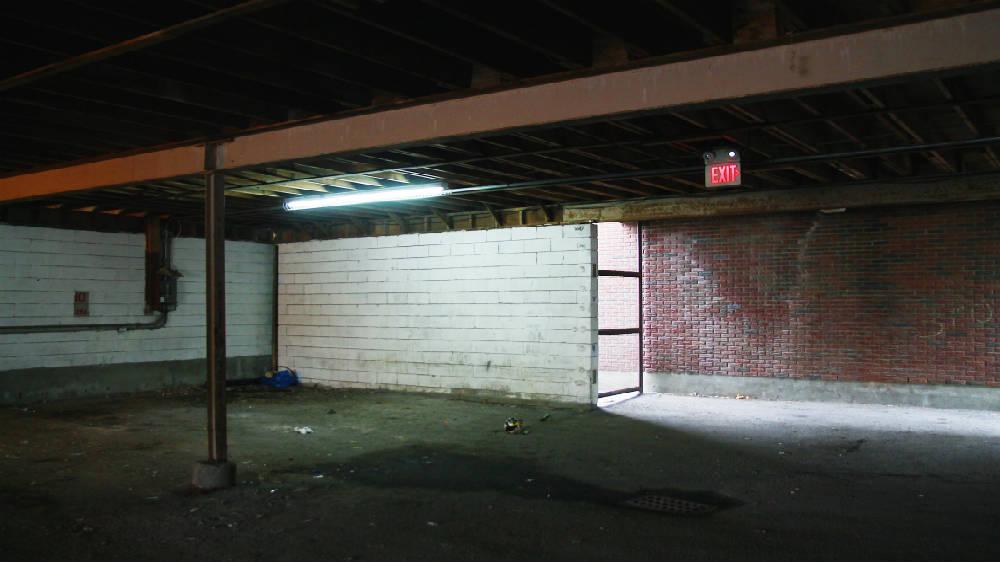 Inside a barren parking garage