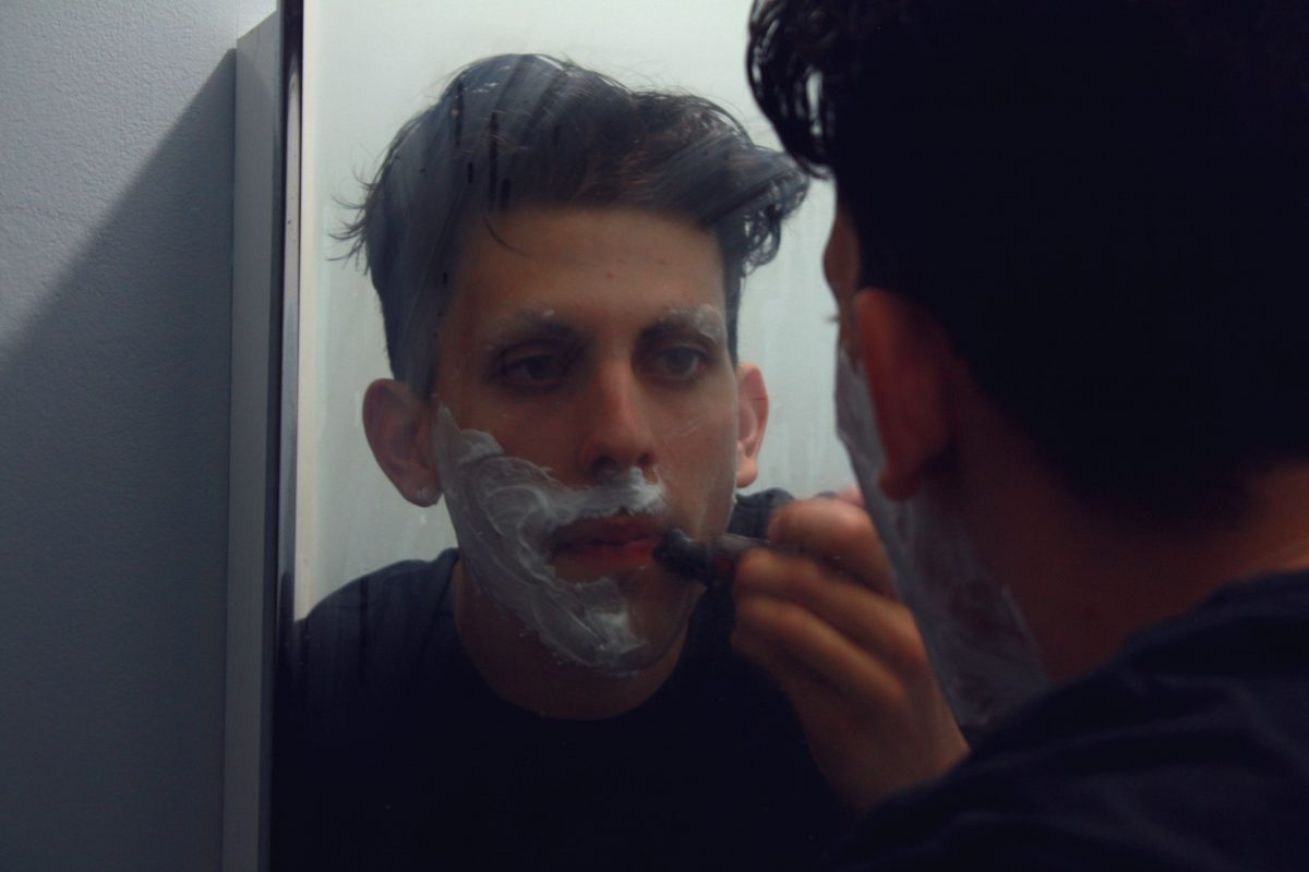 Adrianna Exposée, 19, begins with a shave before a recent hosting gig in downtown Ottawa.