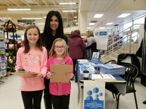 MPP Goldie Ghamari petitioned with future high school students Rachel, 10, and Chelsea, 6, at a Riverside South grocery store. (Photo © Jennifer Liu)