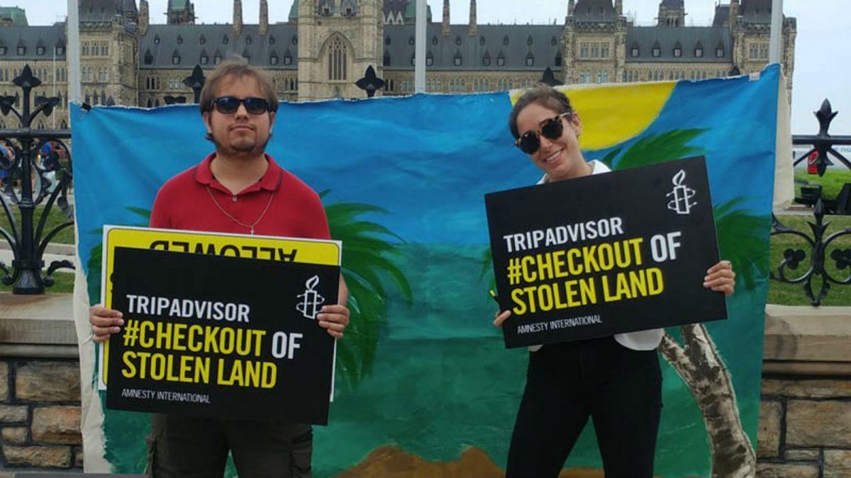 Human rights group protest outside TripAdvisor office over Isreali settlement listings