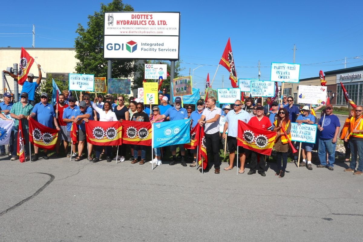 Striking military base cleaners picket Ottawa headquarters