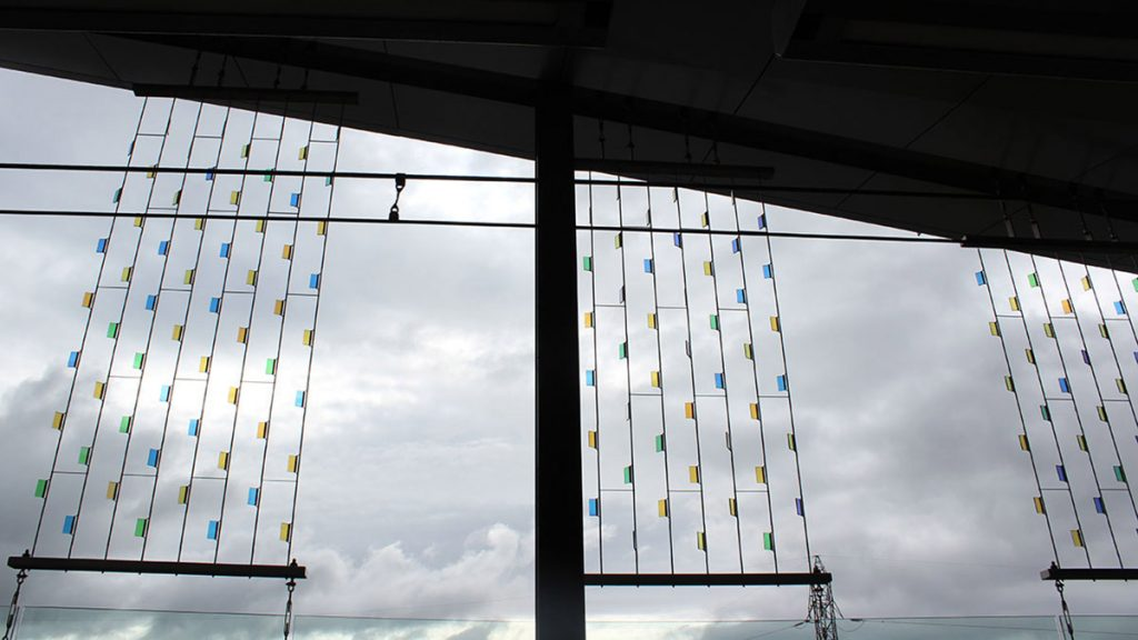 At Blair station, thin coloured glass is strung up vertically and meant to sway in the wind.
