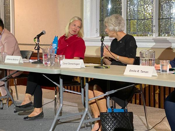 Carol Clemenhagen speaks as Catherine McKenna is shown listening.