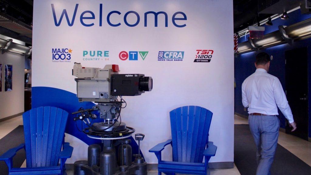 Matthew Skube walking past welcome sign in CTV Ottawa's station.