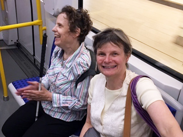 Kim Kilpatrick and Shelley Ann Morris both have visual disabilities, and are shown taking the LRT.