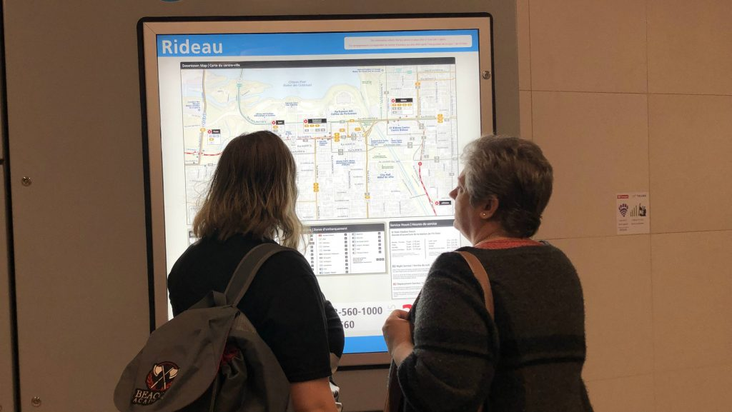 two women looking at the LRT map