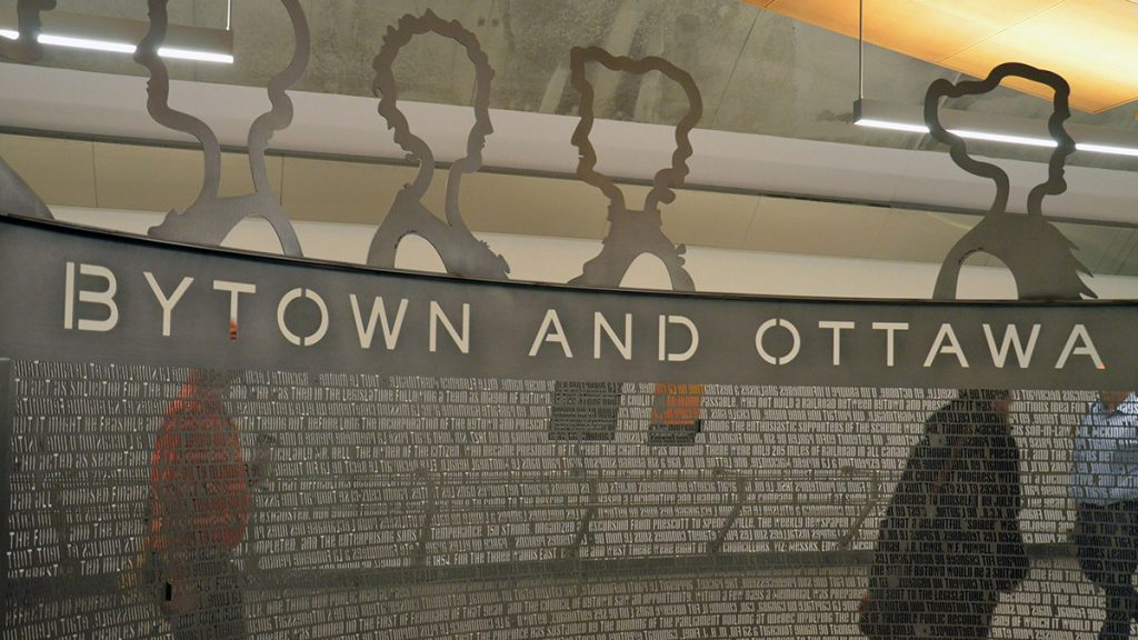 The metal structure in the middle of Lyon station depicts the 32 women who founded the Ottawa chapter of the Women's Canadian Historical Society in 1898.