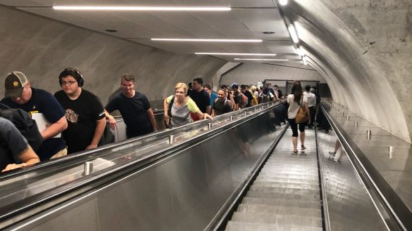 OC Transpo riders take the escalators in the station.