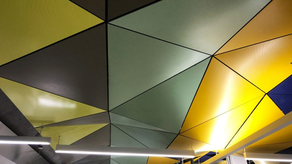 The ceiling of Parliament station is meant to display a sunset with its triangular geometric pattern.