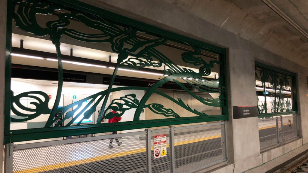 The metal frames dividing the tracks represent nature in the midst of concrete from coast to coast to coast.