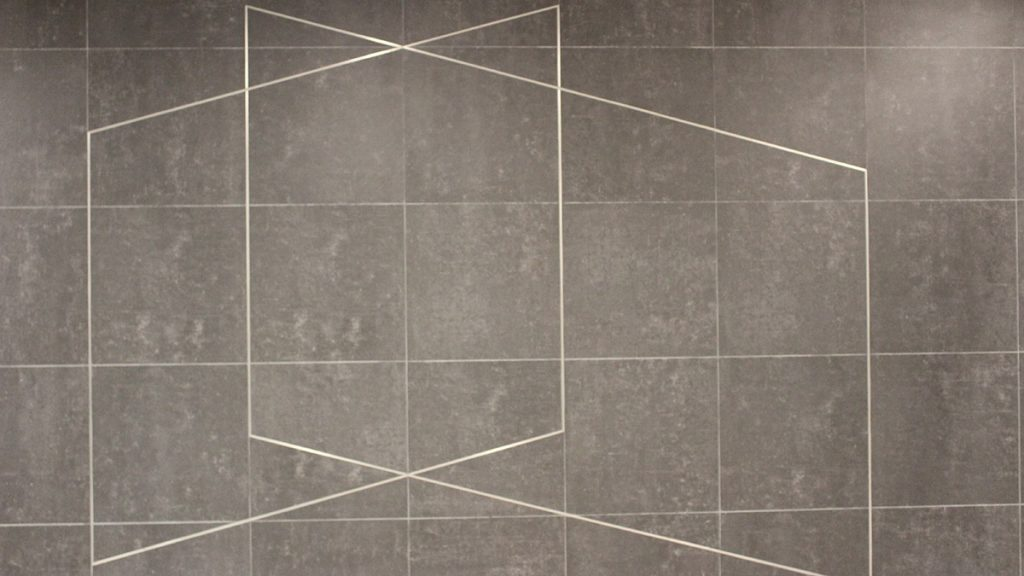 Verburg's silver tile design depicts a page from an architectural blueprint at Rideau station.