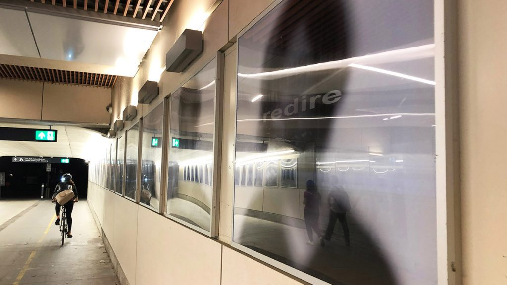 Michael Besant's Train of Thought features black and white portraits along the walls, which are designed to follow you through the tunnel at uOttawa station.