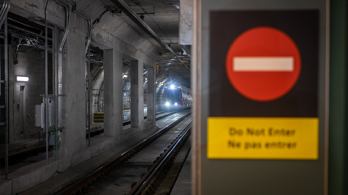 A train approaches a station in an Ottawa LRT tunnel.