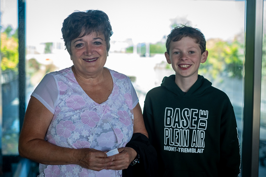 Cynthia Soucy and her grandson pose at an LRT station.