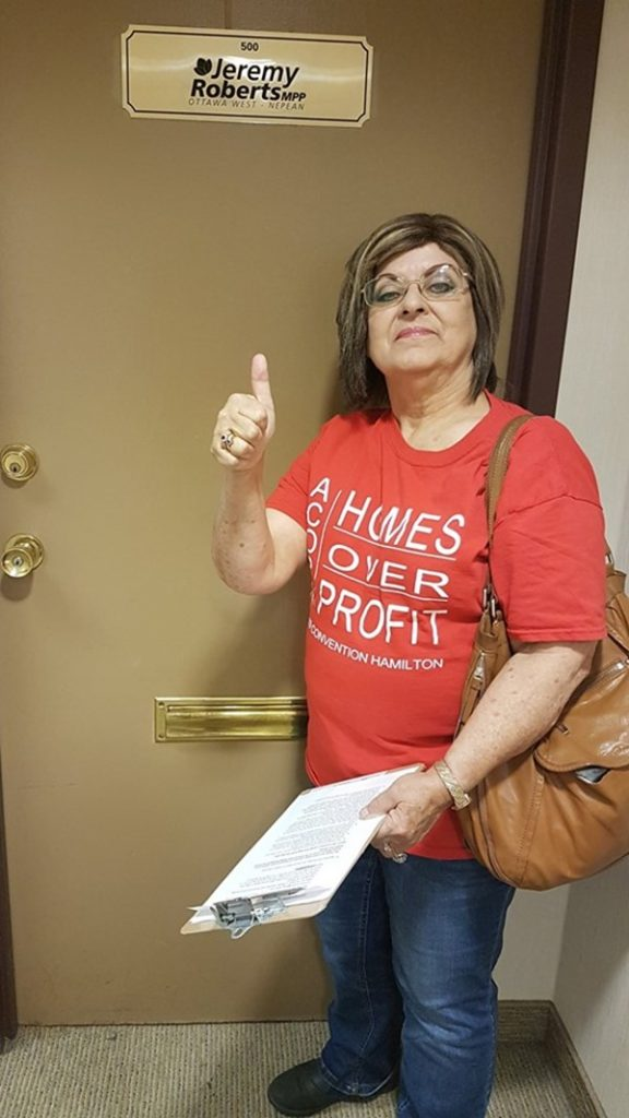 Activist Mavis Finnamore stands in front of MPP Jeremy Roberts office, holding the letter she will present to him.