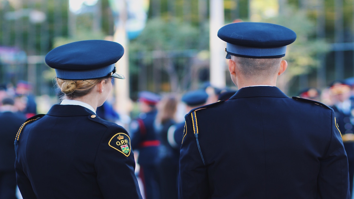 The backs of two OPP officers