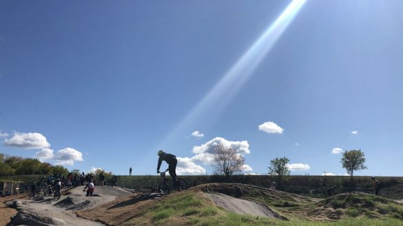 a biker is illuminated by a ray of sun on the new bike park