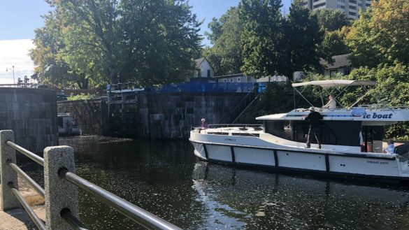 A boat waiting to pass through the locks at the Hogs Back Lockstation on the Rideau Canal