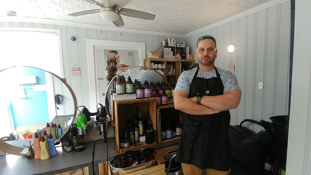 Lucas Nault stands inside the Organic Salon.
