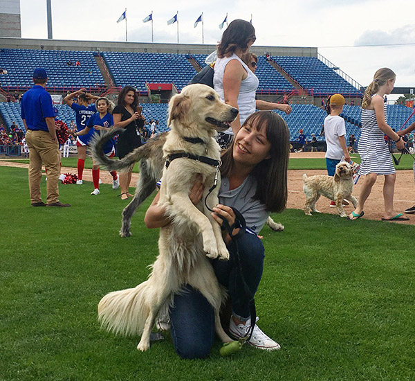 A dog on the RCTG field with her owner.