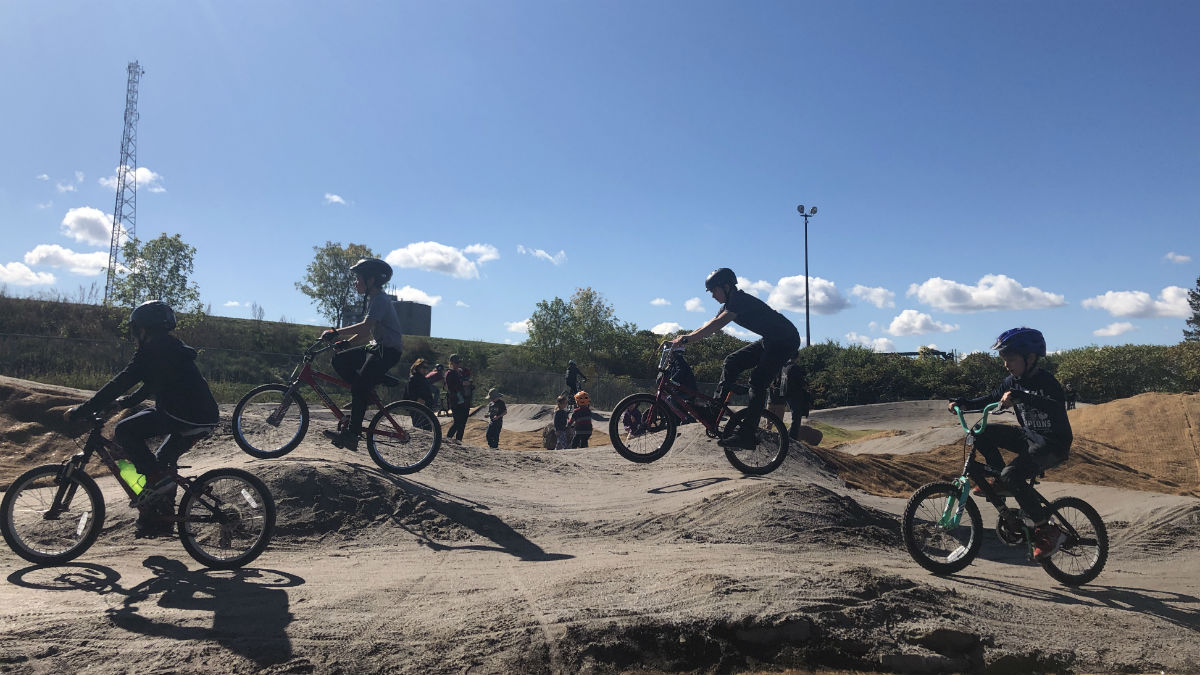 Kids enjoy the new bike park on opening day.
