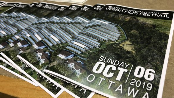 Programs of the Ottawa International Vegan Film Festival laid out on a desk with its logo and the date, Sunday October 06, 2019.