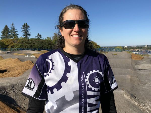 Sandra Beaubien stands in front of the new Carlington Bike Park.