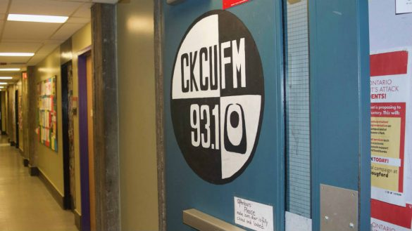 CKCU FM sign on door leading into the hallway of the station.