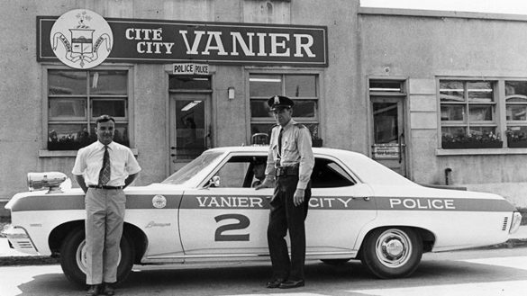 An old photo of the City of Vanier's police department with a few police officers and a police car