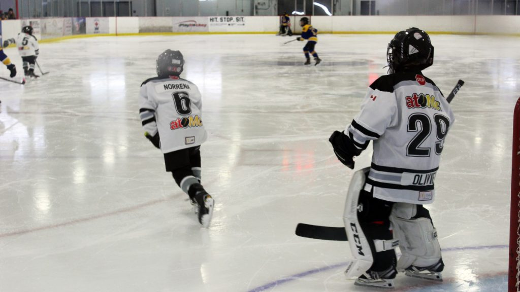 A youth goalie standing tall in net at the Jim Durrell Recreation Centre in Ottawa.