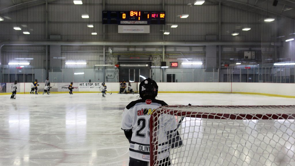Behind the net view at the  Jim Durrell Recreation Centre in Ottawa. As a pewee boys team compete in a game.