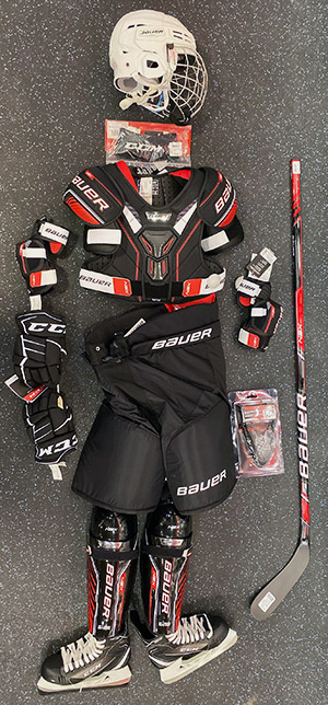 Hockey equipment sourced from SportsCheck. Includes: Helmet, neck guard, shoulder pads, elbow pads, gloves, pants, jock, shin guards, stick and skates.