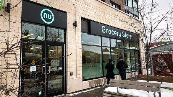The outside storefront of NU Grocery's Wellington West location.