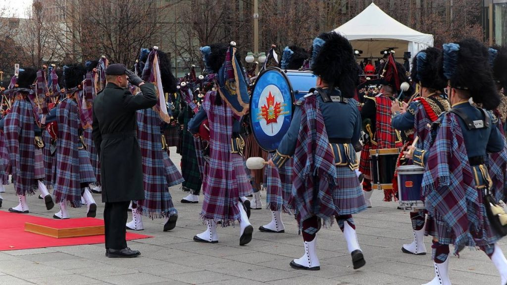 Royal Canadian Air Force playing instruments while marching on Remembrance Day.