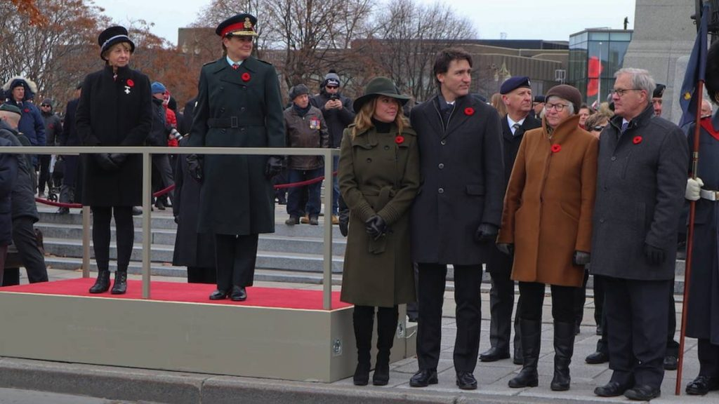 Reine Samson Dawe, this year's Silver Cross Mother, waiting for the veteran march off with Gov. Gen. Julie Payette, Sophie Grégoire Trudeau and Prime Minister Justin Trudeau.