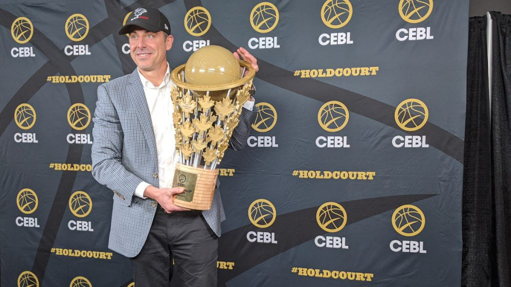 The CEBL Championship trophy held by CEO and commissioner Mike Morreale.