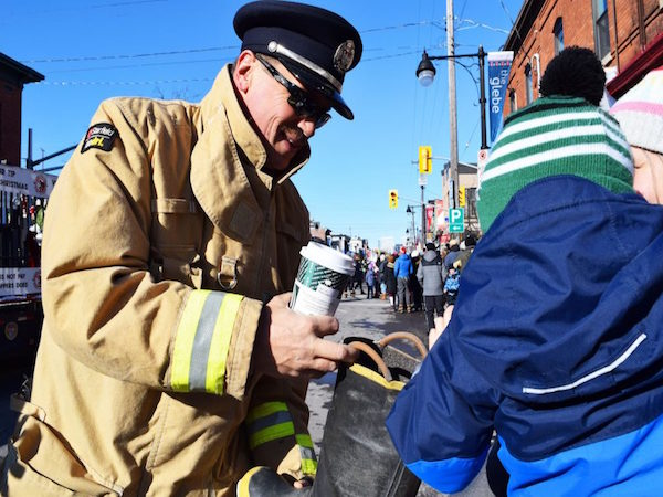 Firefighter accepts a toy donation.
