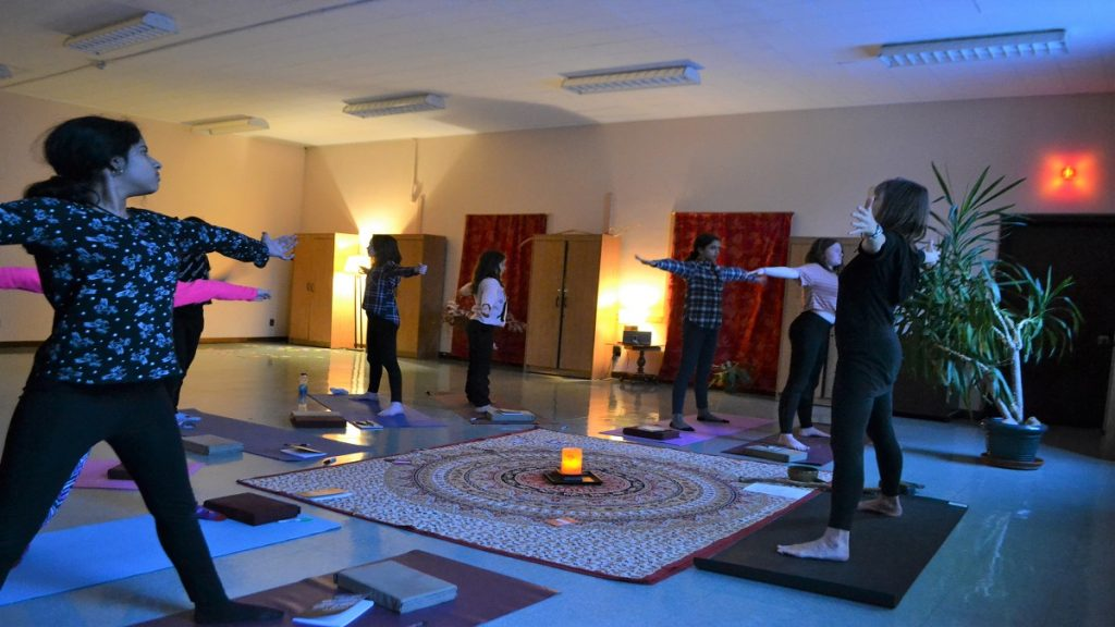 Kids practice a five-pointed star pose at a class a Surround Circle Yoga.