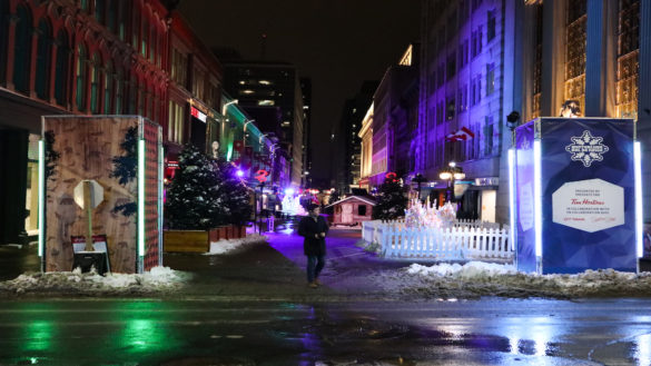 A night scene of Sparks Street during interlude, with a single person walking in the middle.