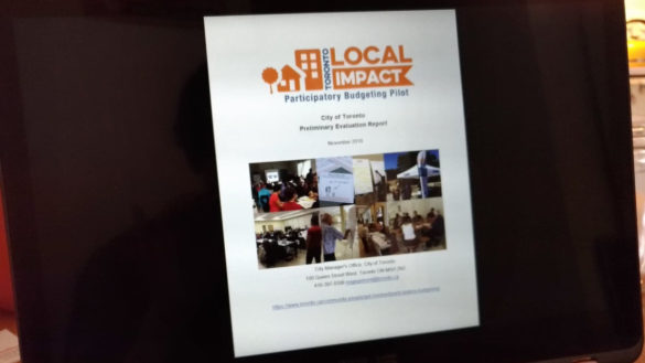 A laptop screen showing the Preliminary Evaluation Report for Toronto's participatory budgeting pilot