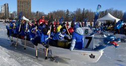 The first set of racers racing down the Rideau Canal Skateway for the World Ice Dragon Boat Championships