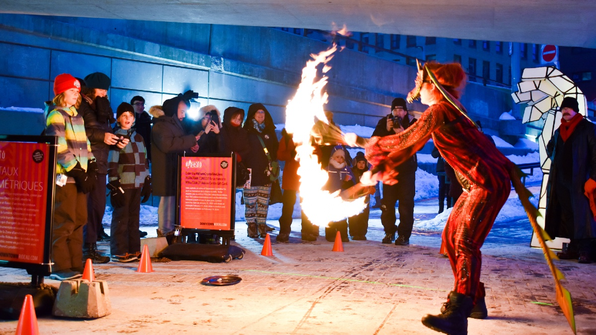 A fire dancer spins around their batons at the Rideau Underpass. [Photo © Georgia Andromidas]
