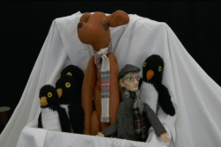 A variety of puppets positioned together.