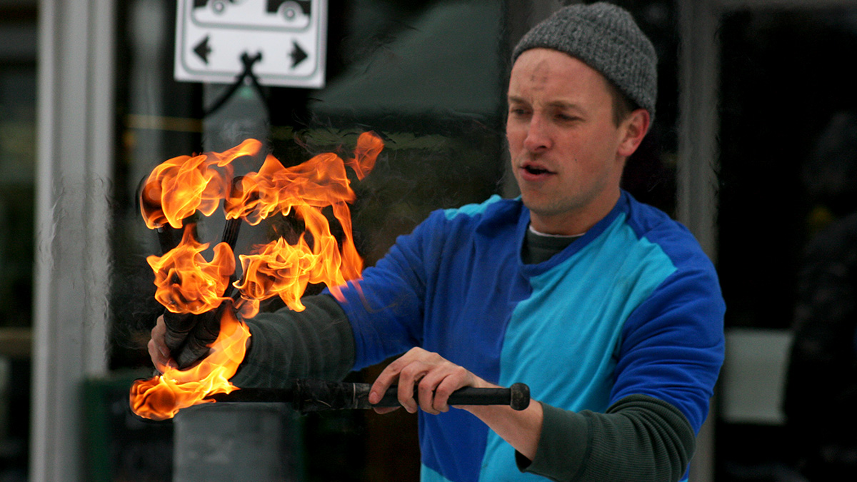 Juggler playing with fire at Winterlude