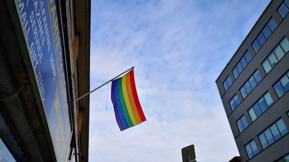 Pride flag hangs over a convenience store on Bank Street.