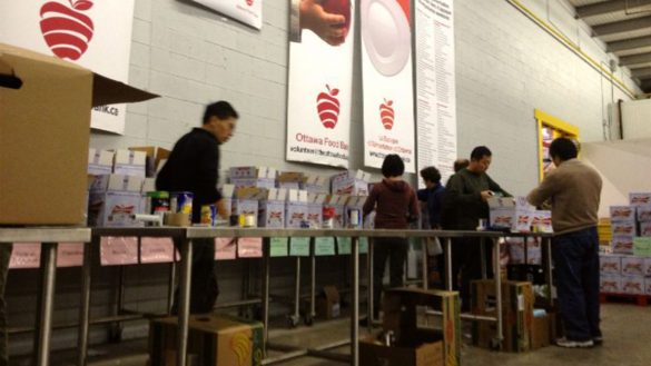 Ottawa Food Bank volunteers sort donations in this 2013 file photo.