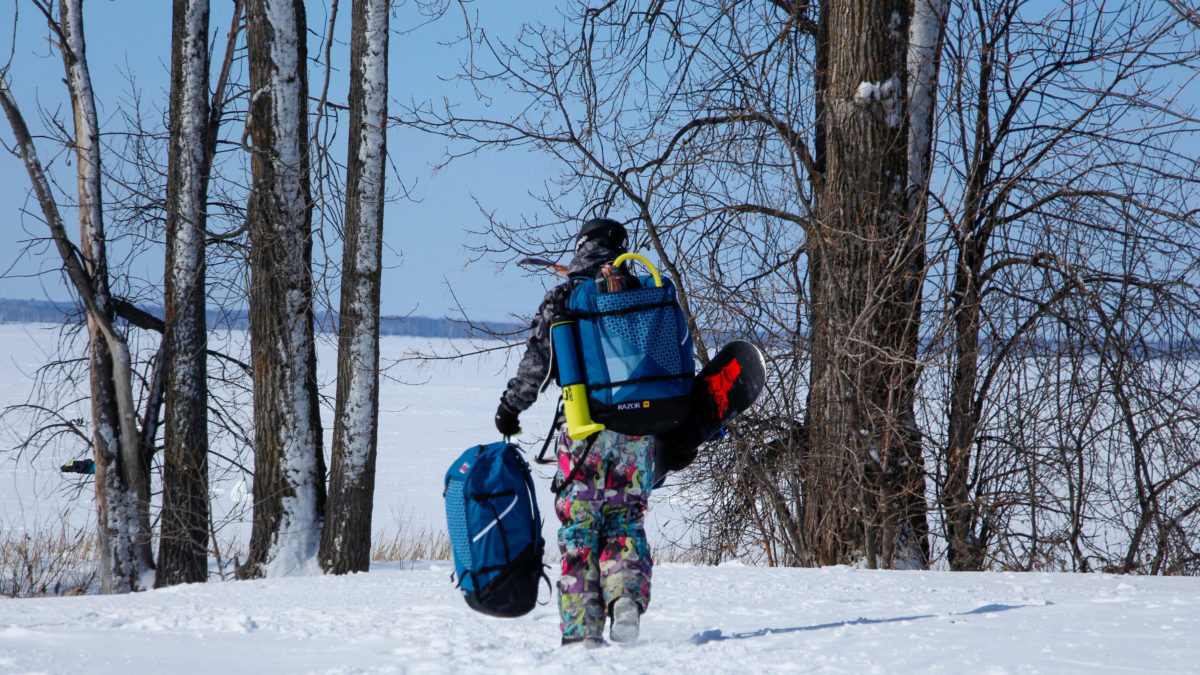 With all of his gear, Campbell walks towards a snow-covered Britannia beach, the spot where he kiteboards.