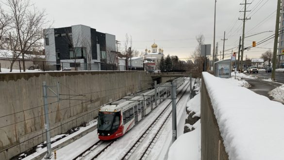 A train passes through a trench in the Mechanicsville neighbourhood in Ottawa.